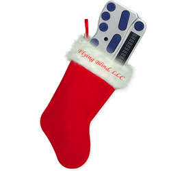 Photo of a bright red holiday stocking with Flying Blind, LLC embroidered across the top and a brand new BraillePen 12 sticking out of the top of the stocking.