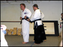 Photo of the LTrain adjusting the fit of his new Black Belt.