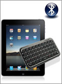 Photo of an Apple iPad connected to a small Bluetooth wireless QWERTY keyboard by the universal Bluetooth symbol.